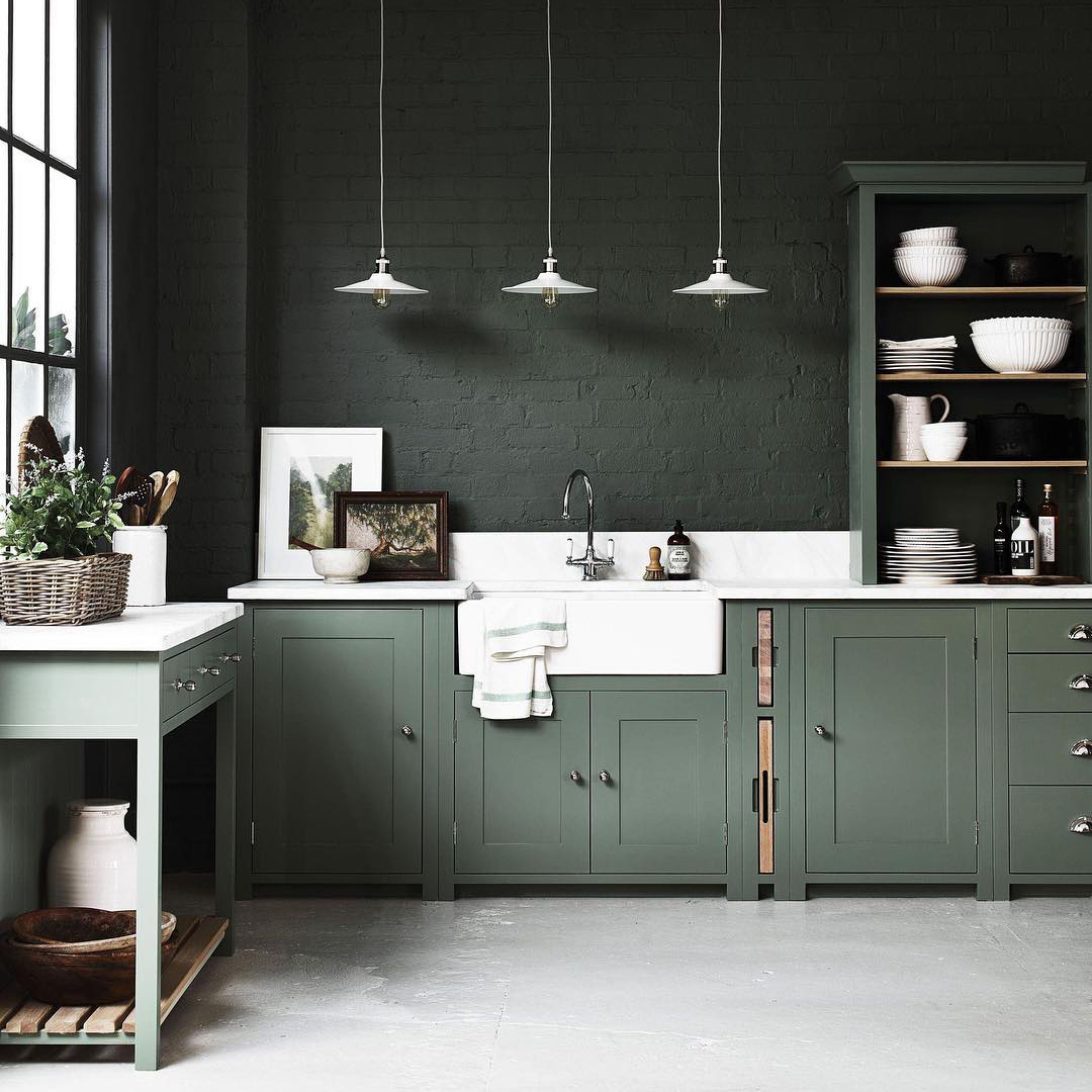 Darker colors returned to 2018 kitchens this year — think navy, hunter green, walnut, and slate gray.